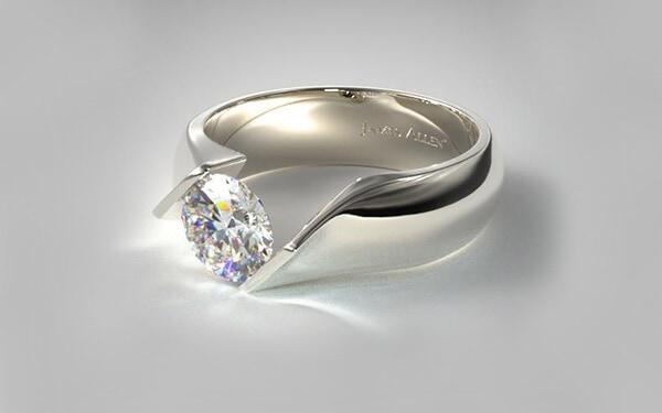 Contoured 14 k white gold with twist tension set engagement diamond